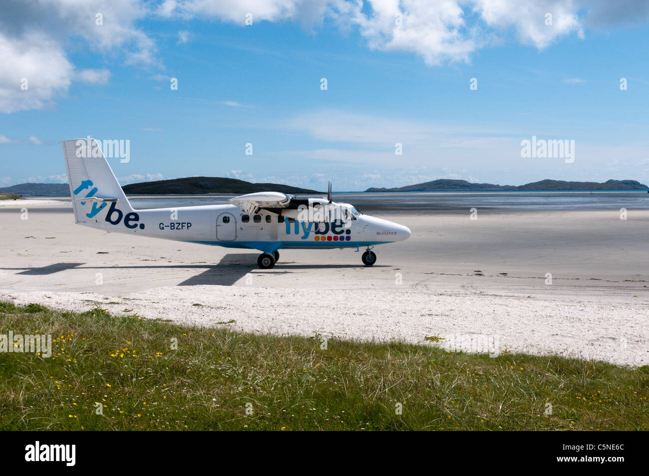 A de Havilland DHC-6 Twin Otter plane of Flybe - Loganair on the beach airstrip on the island of Barra in the Outer - Stock Image