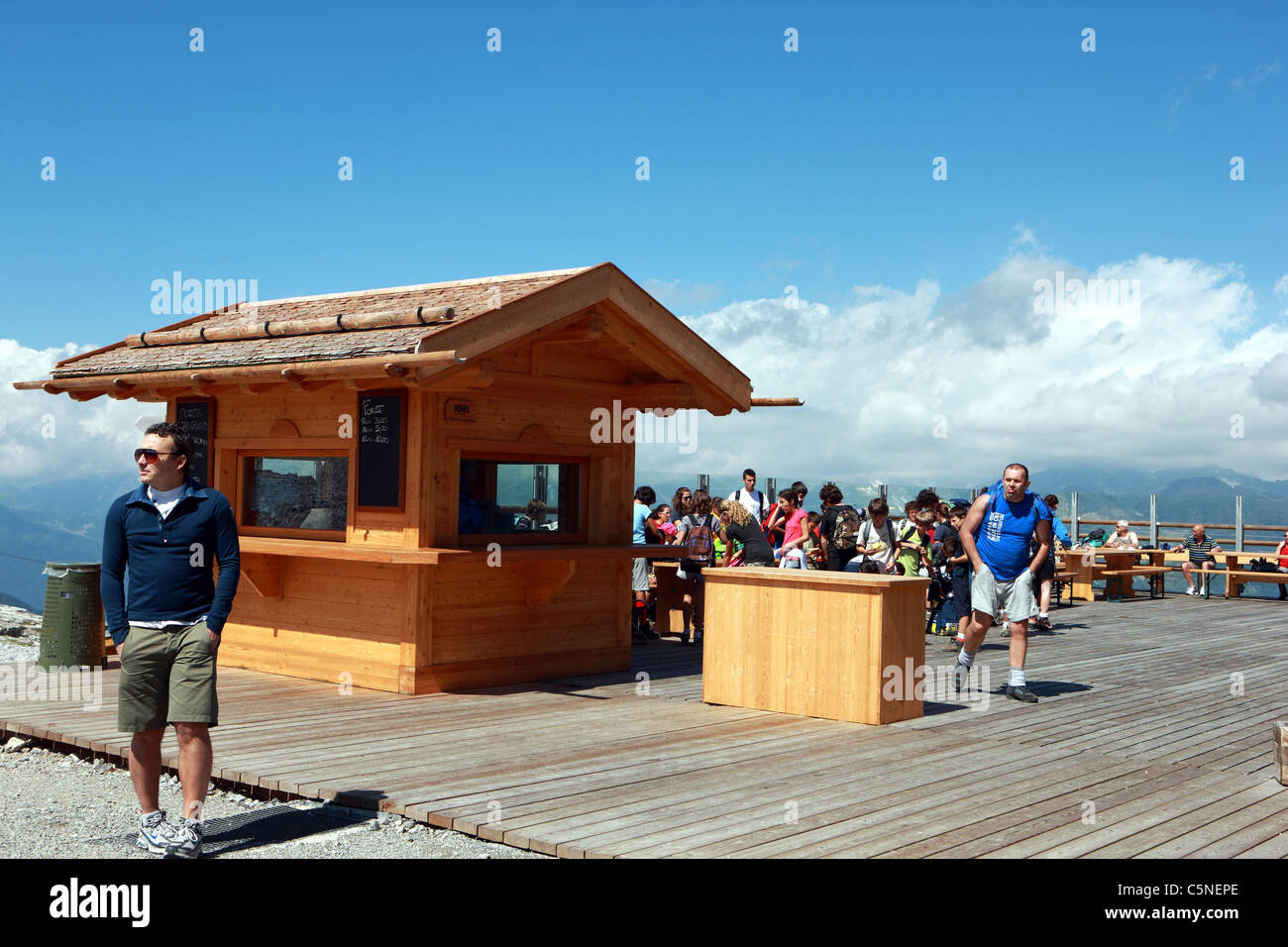Outdoor seating area at Passo del Groste the gondola top station at 2442m in the Italian Brenta Dolomites - Stock Image