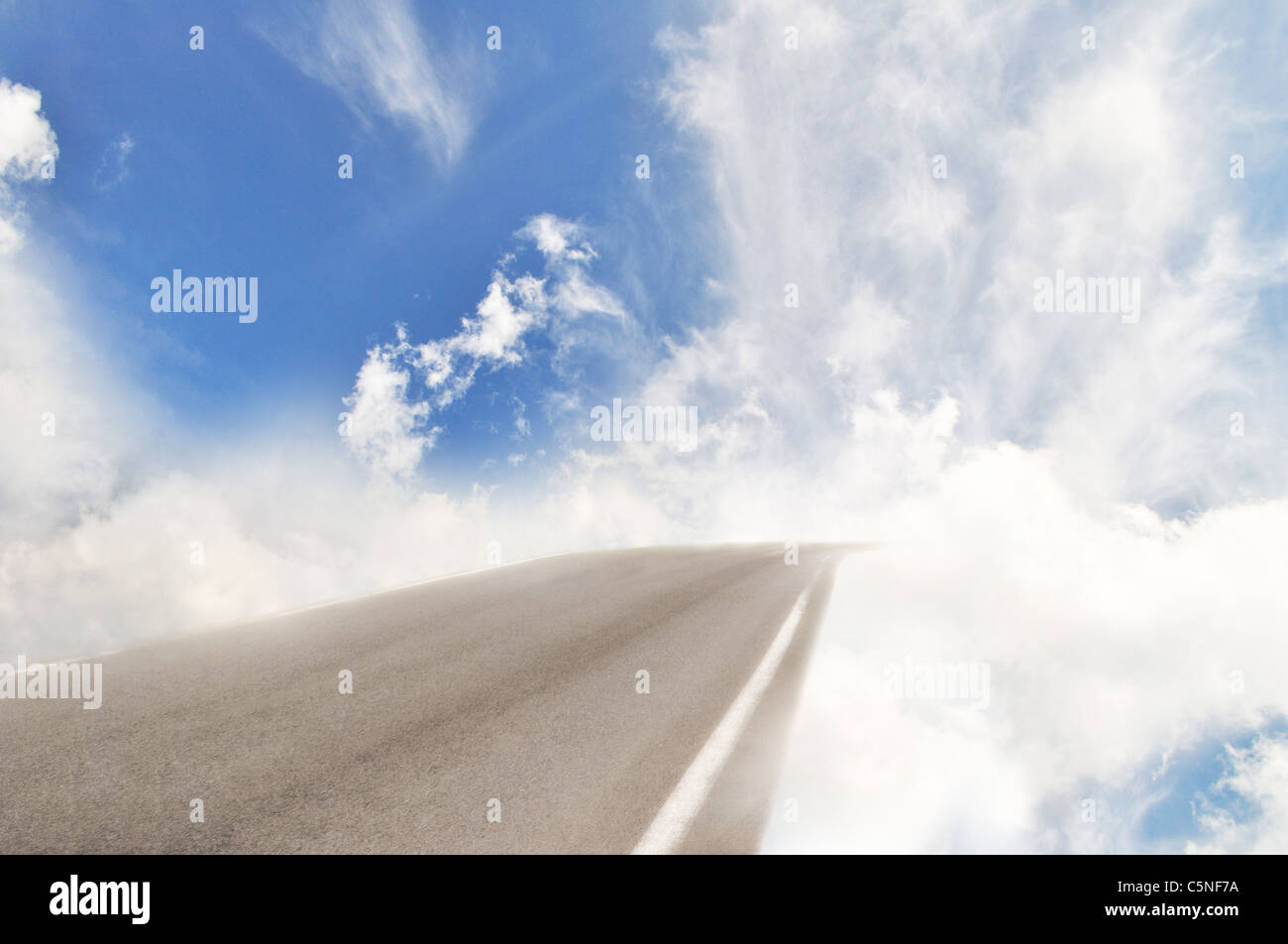 Heaven road turn into clouds on blue sky - Stock Image