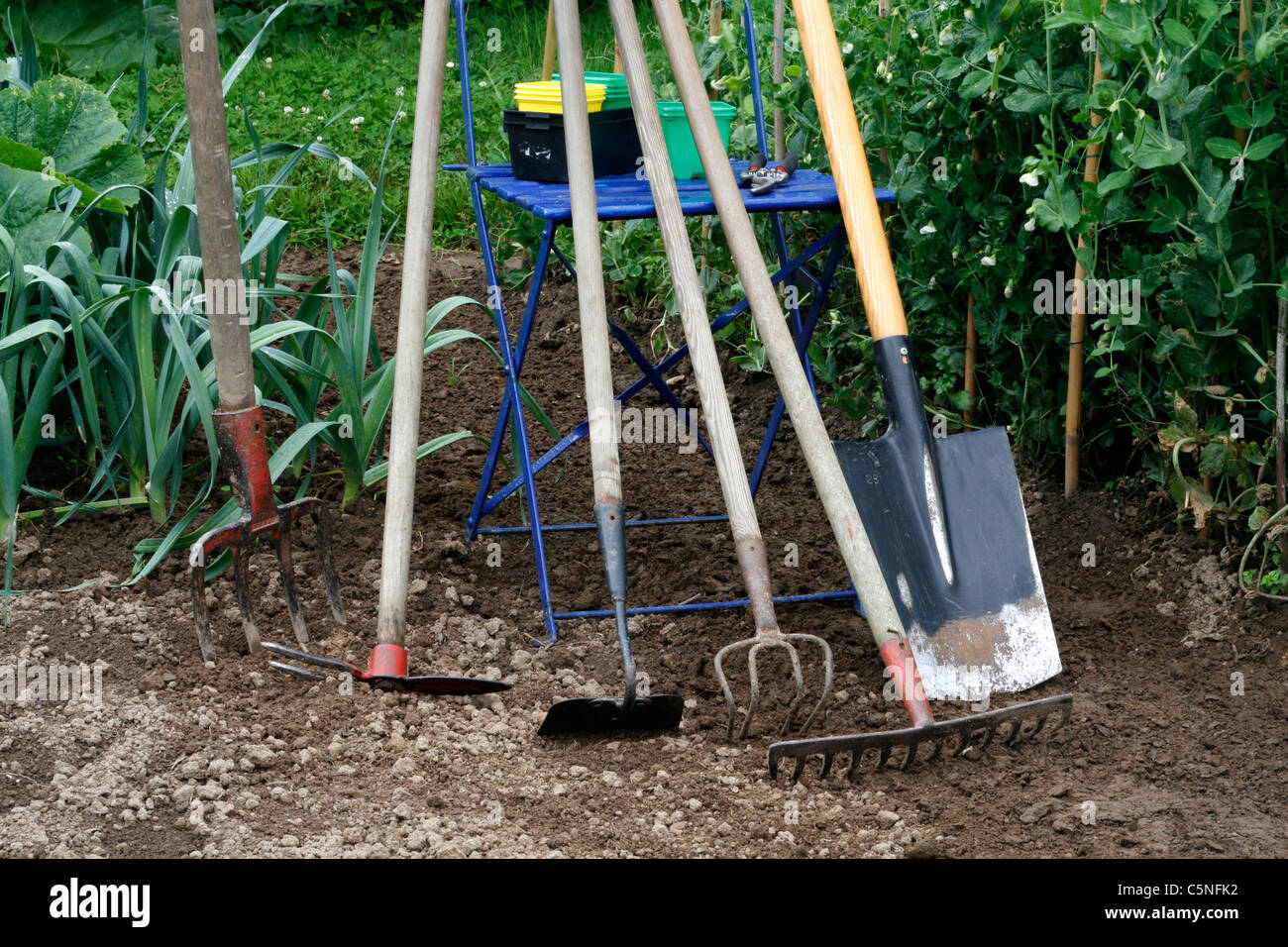 The Tools Of The Vegetable Garden Fork Hoe Claw Rake Spade