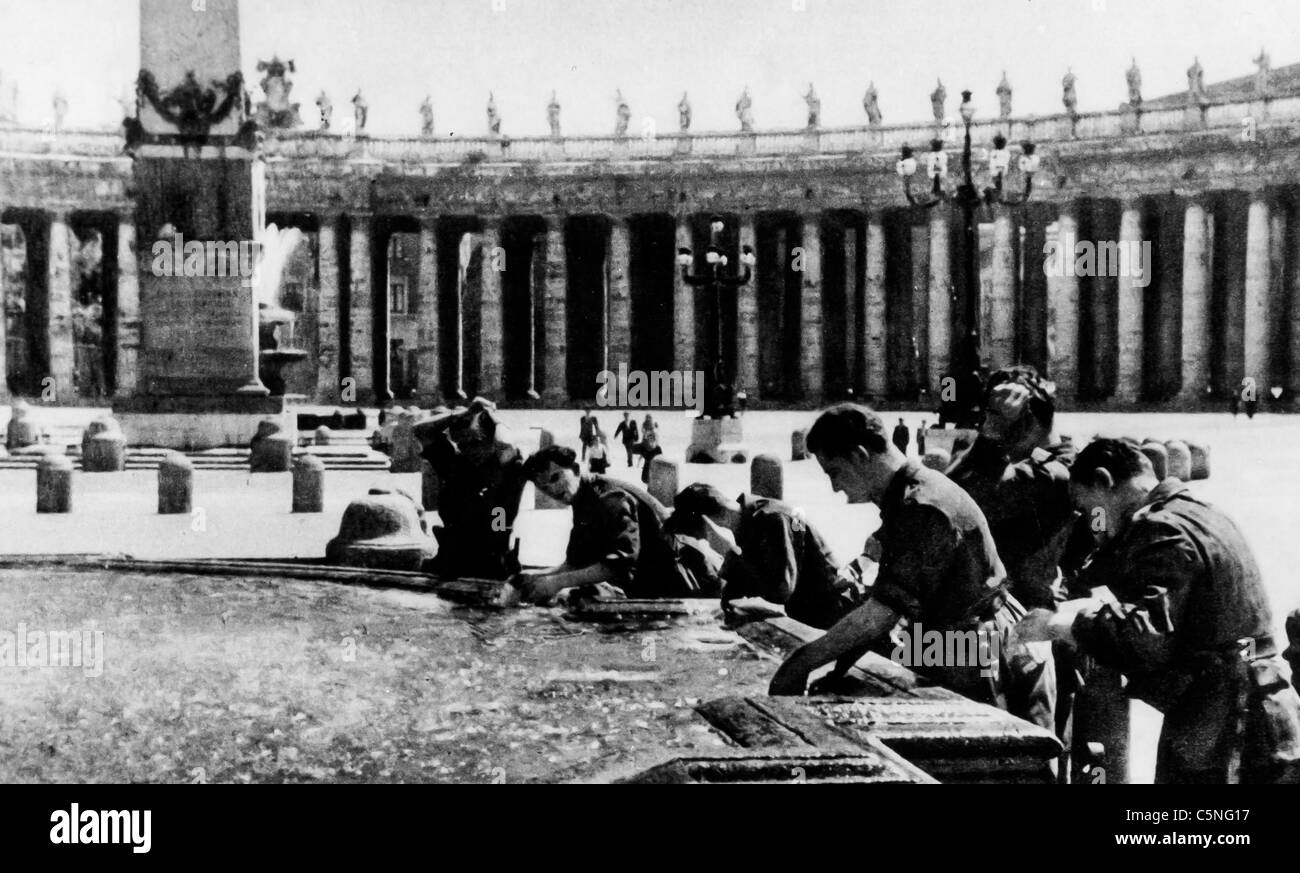 German troops drink at the fountain in St. Peter's,Rome,World War II,1944 - Stock Image