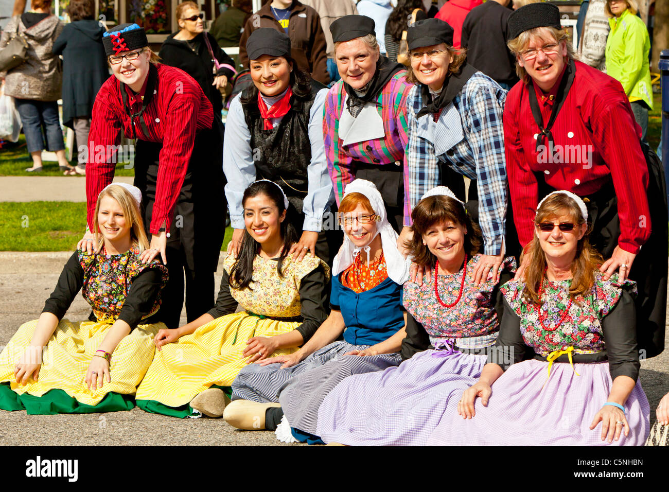 Dutch people posing in a group in ethnic dress in Holland, Michigan, USA. - Stock Image