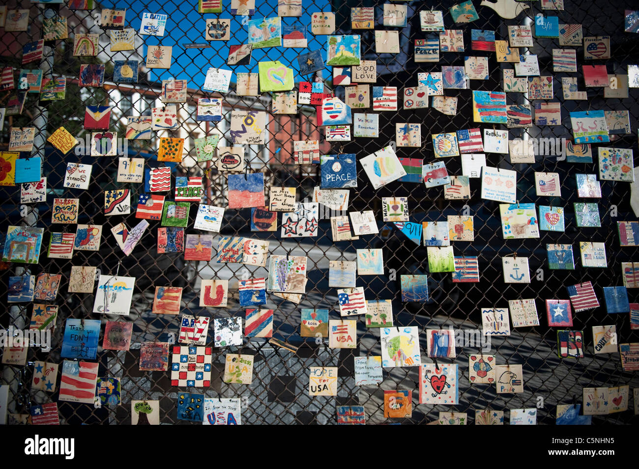 GREENWICH VILLAGE. Dozens of the 9/11 memorial tiles that hung on a fence in the Village from the days after terrorist - Stock Image