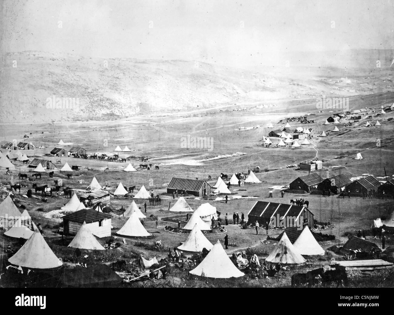 CRIMEAN WAR (1853-1856) 5th Dragoon Guards encampment. Black buildings are stables for their horses - Stock Image