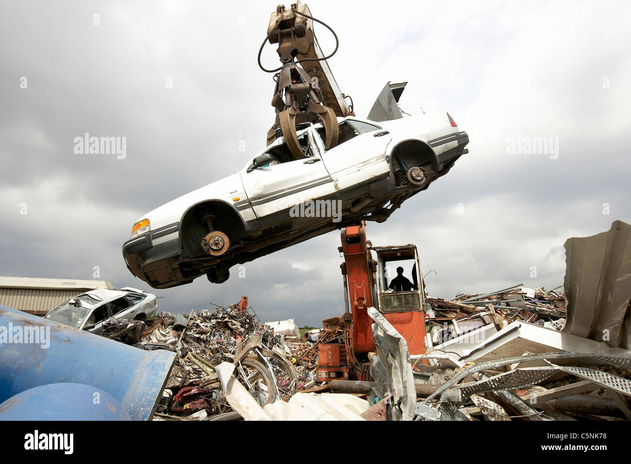 Crane lifting car for scrap metal during the recycling process in a ...