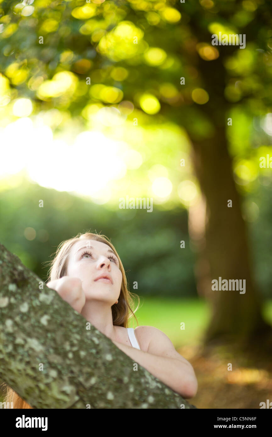 a young caucasian woman outdoors in a woodland glade, uk - Stock Image