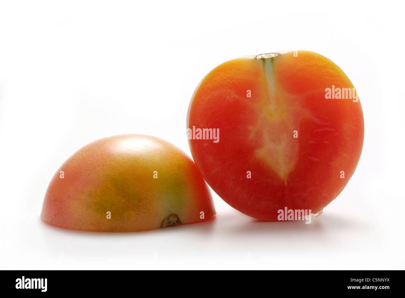 Tomato varieties:  Madagaskar, two halves - Stock Image