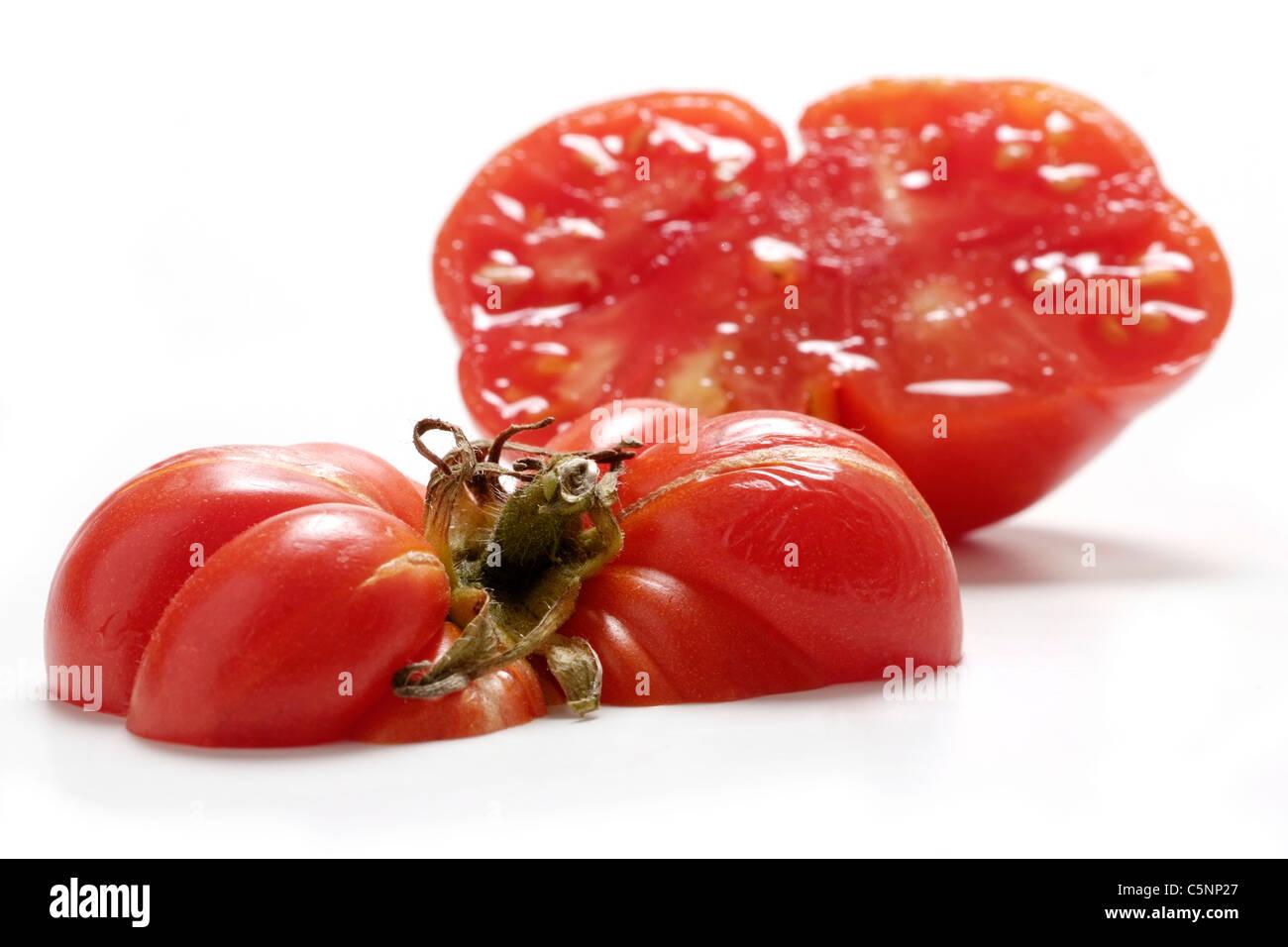 Tomato varieties:  Reisetomate Zorn, two halves - Stock Image