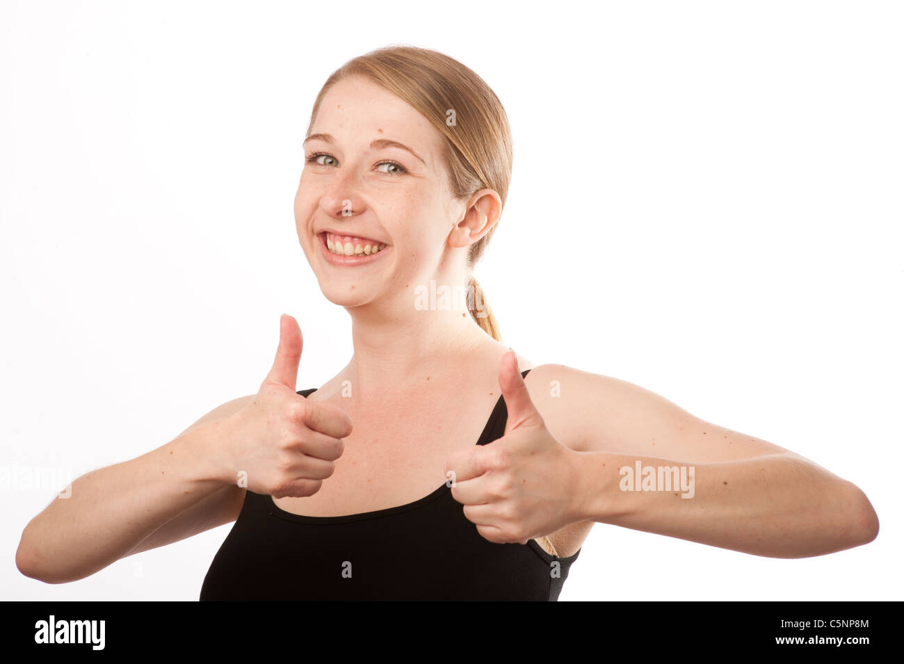 a young caucasian woman with her two thumbs up looking positive, uk - Stock Image