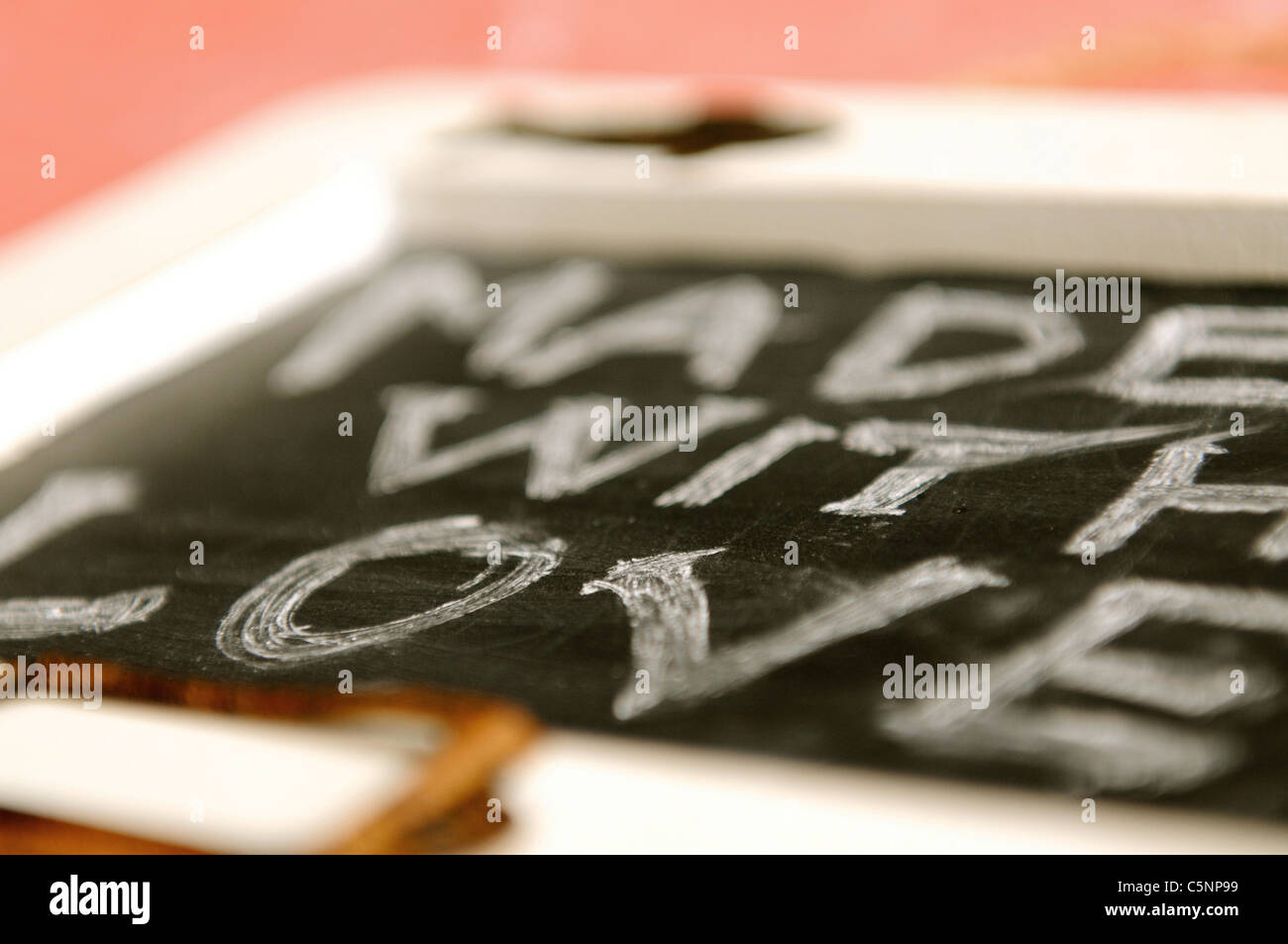 Made with love  - written with chalk on a little blackboard - Stock Image