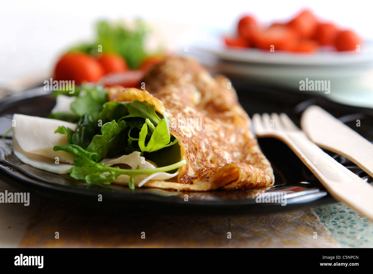 Pancake with ham and cheese and rocket - Stock Image