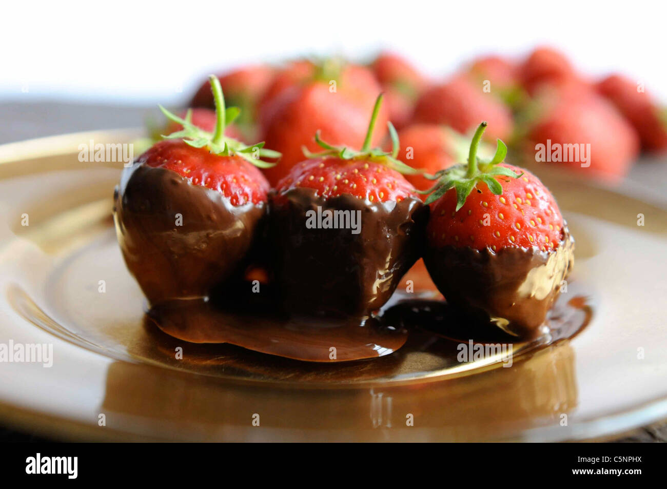 Strawberries with chocolate - Stock Image