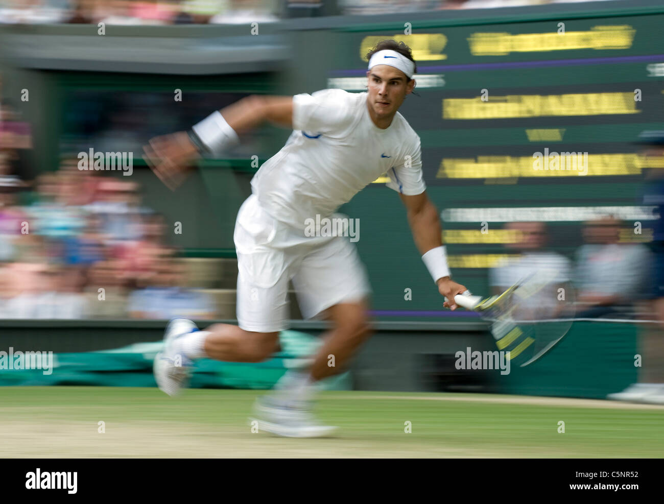 Effect of Rafael Nadal (ESP) running across the court during the Wimbledon Tennis Championships 2011 - Stock Image