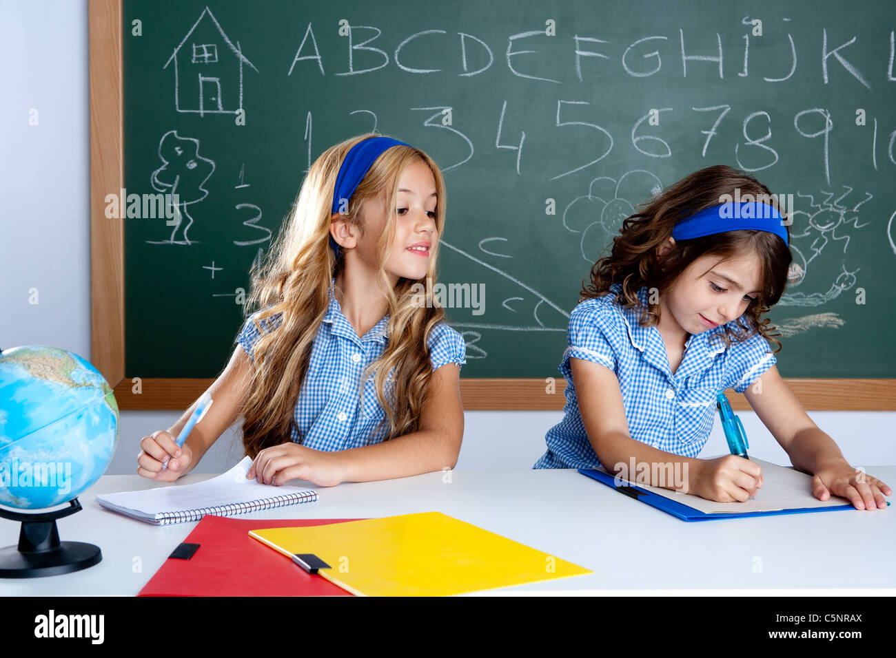 classroom with two kids students cheating on test exam at