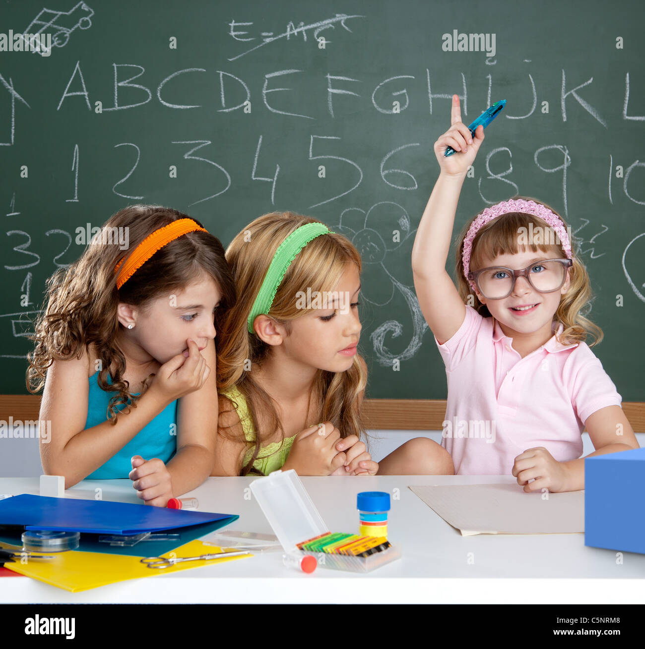boring student with clever children girl raising hand finger at school classroom - Stock Image