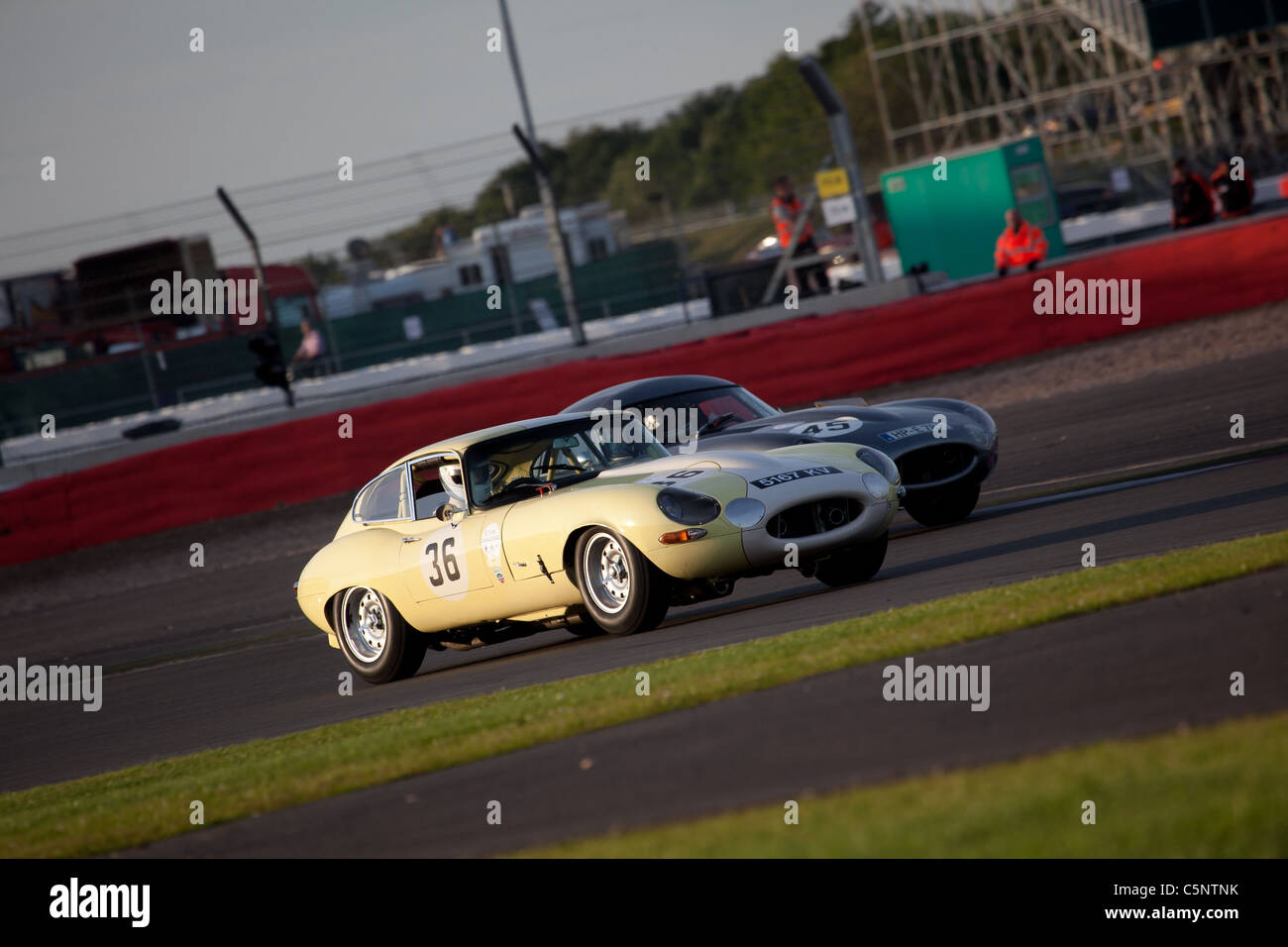 E-Type Jaguar racing in the E-Type Challenge at the Silverstone Classic 2011. - Stock Image