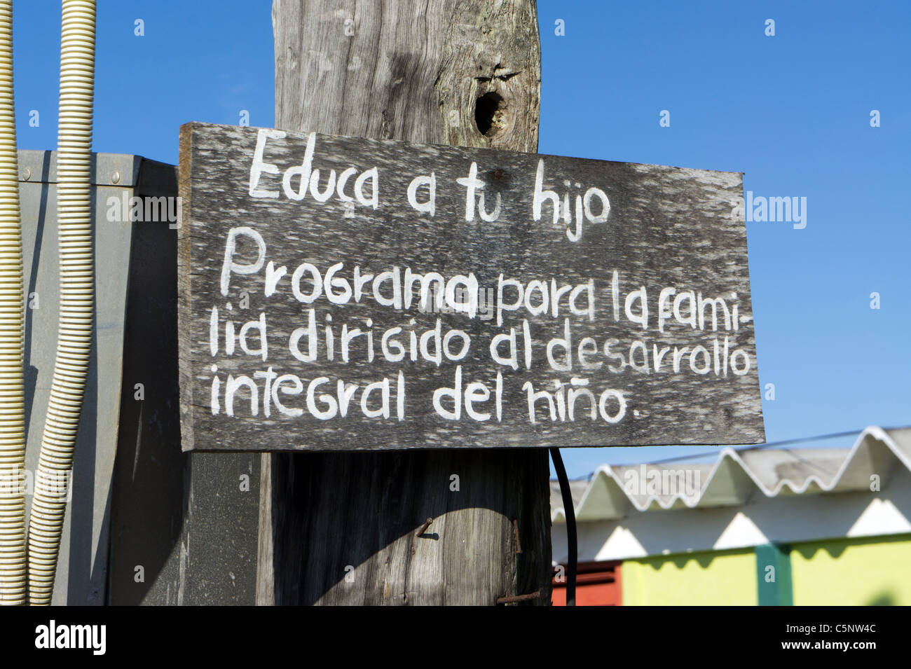 """""""Educate your child-The family program aimed at developing the whole child"""", Cuban propaganda sign, Playa Giron, Stock Photo"""