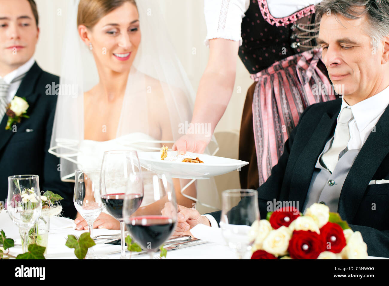 Wedding party at dinner - the dish is going to be served - Stock Image