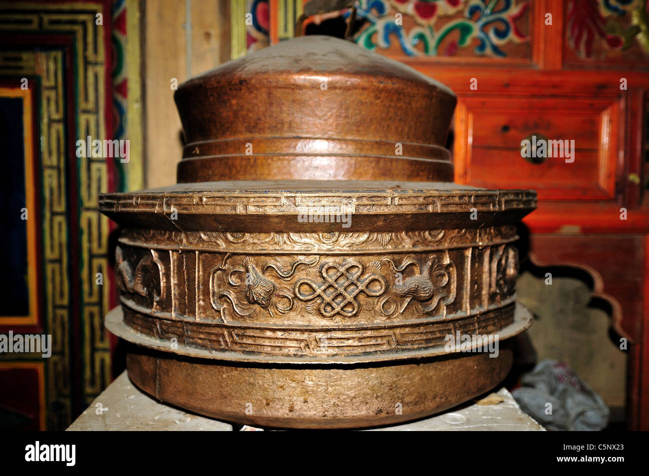 A copper cooking pot with Tibetan style decorations. Daocheng Yading, Sichuan, China. - Stock Image