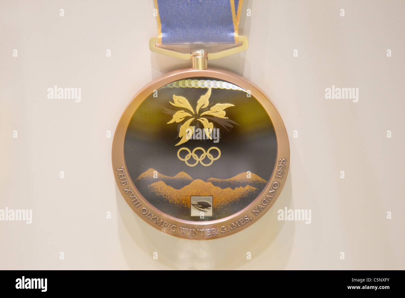 Bronze medal for Nagano winter Olympics : History of the Olympics in Japan. at Japan Mint in Osaka. - Stock Image