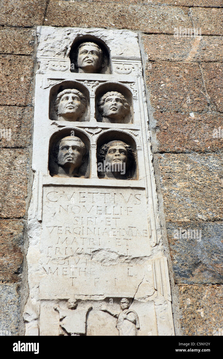 Milan Archi di Porta Nuova which is part of the medieval wall decorated with copies of 1st Century AD Roman tombstones Stock Photo