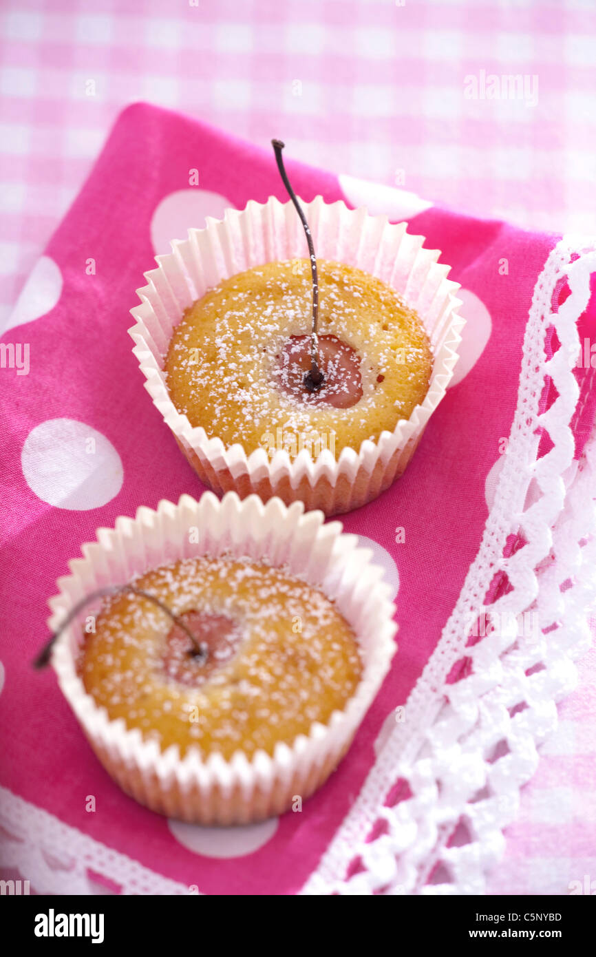 Mini muffins with whole cherry - Stock Image