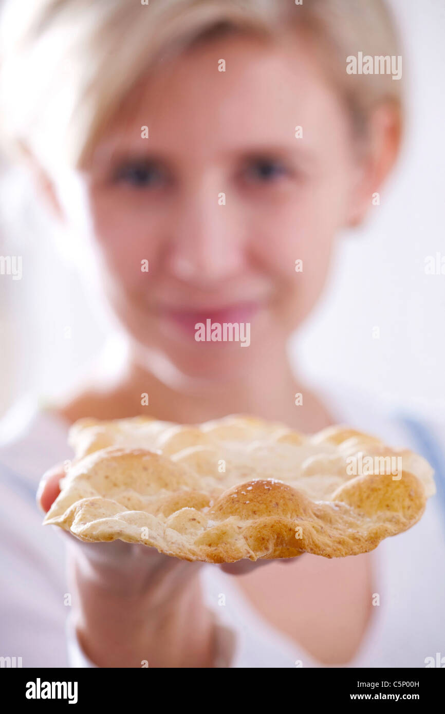 Woman holding a piece of fresh Matzah - Stock Image