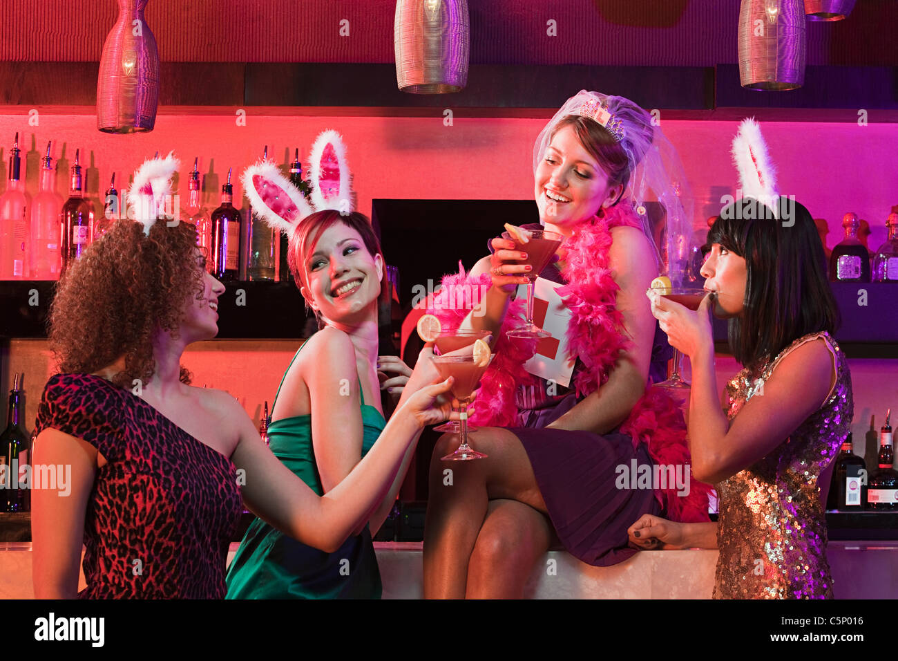 Four young women on hen night - Stock Image