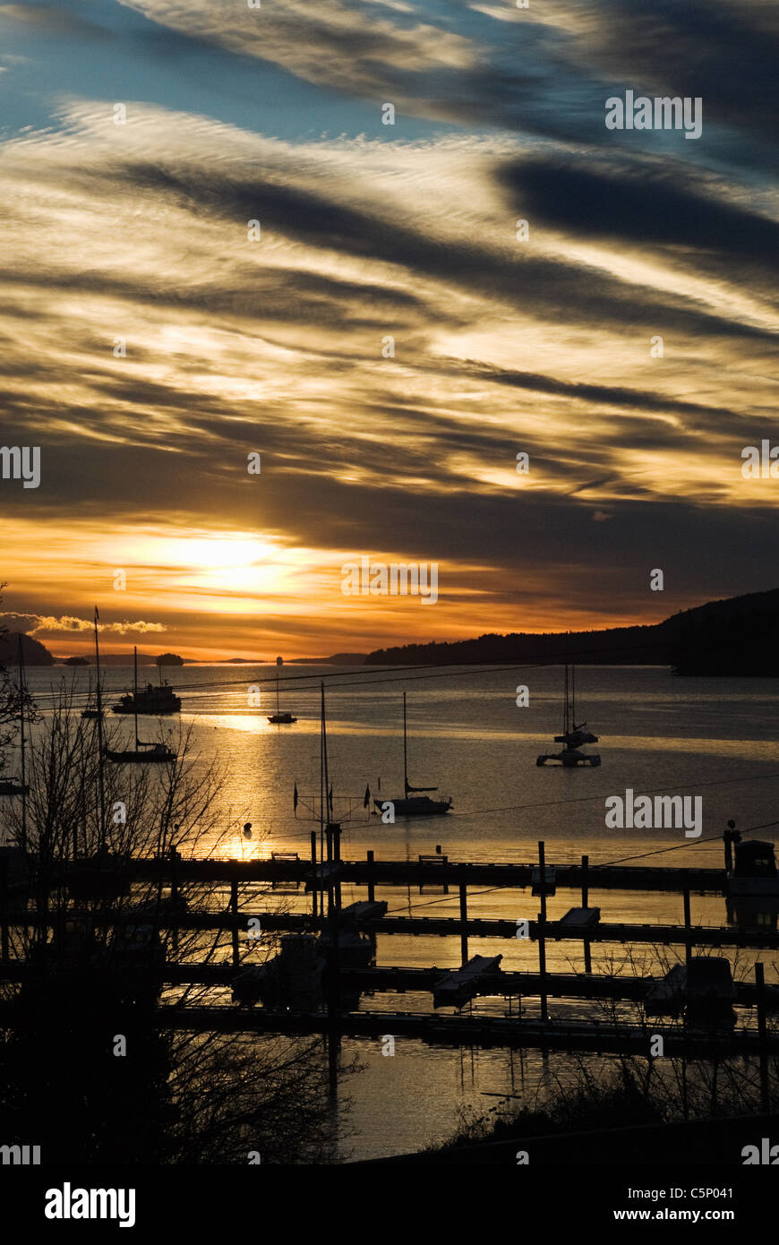 Silhouetted boats on sea, Salt Spring Island, British Columbia, Canada - Stock Image