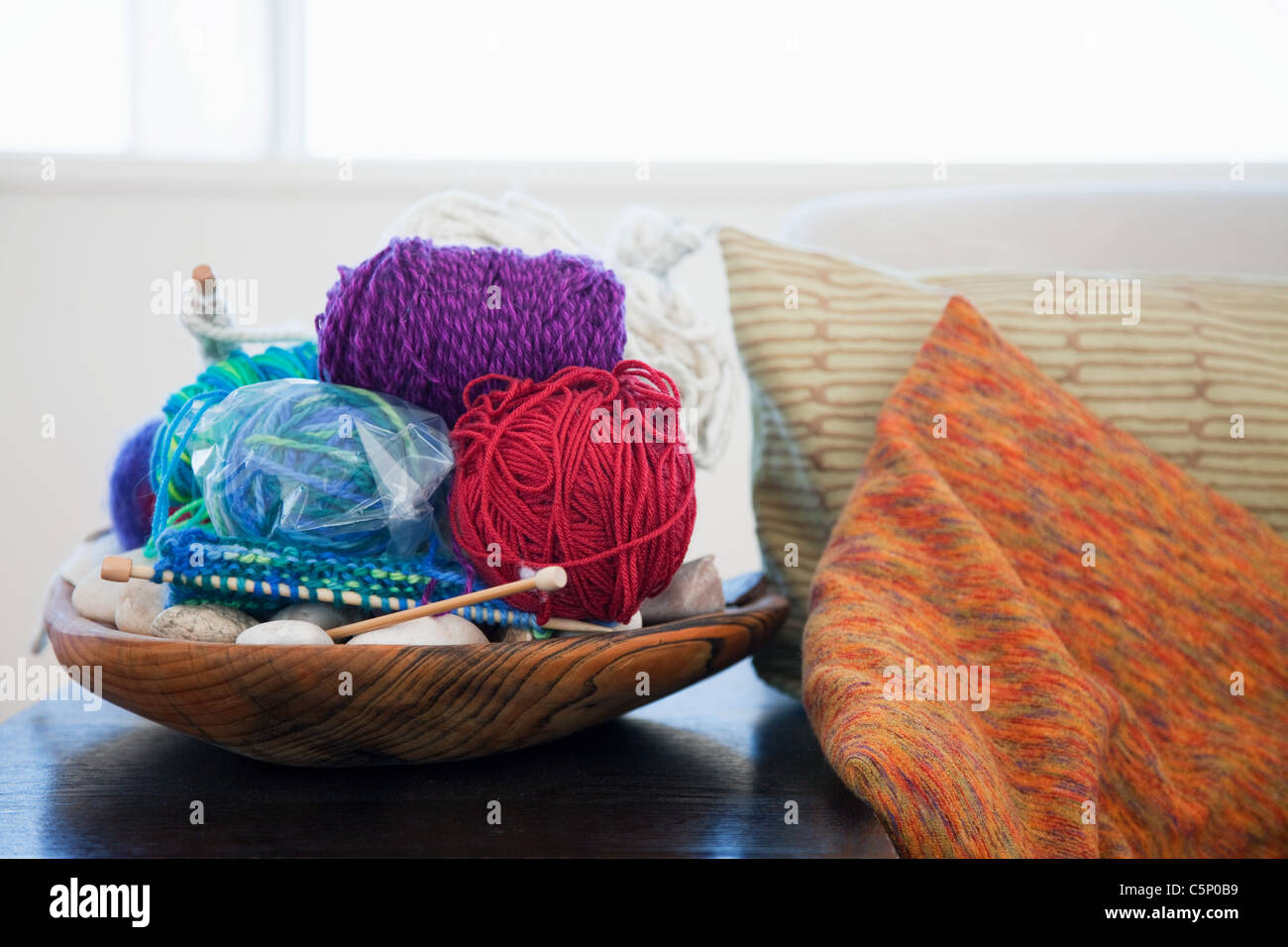 Balls of wool and knitting needles - Stock Image
