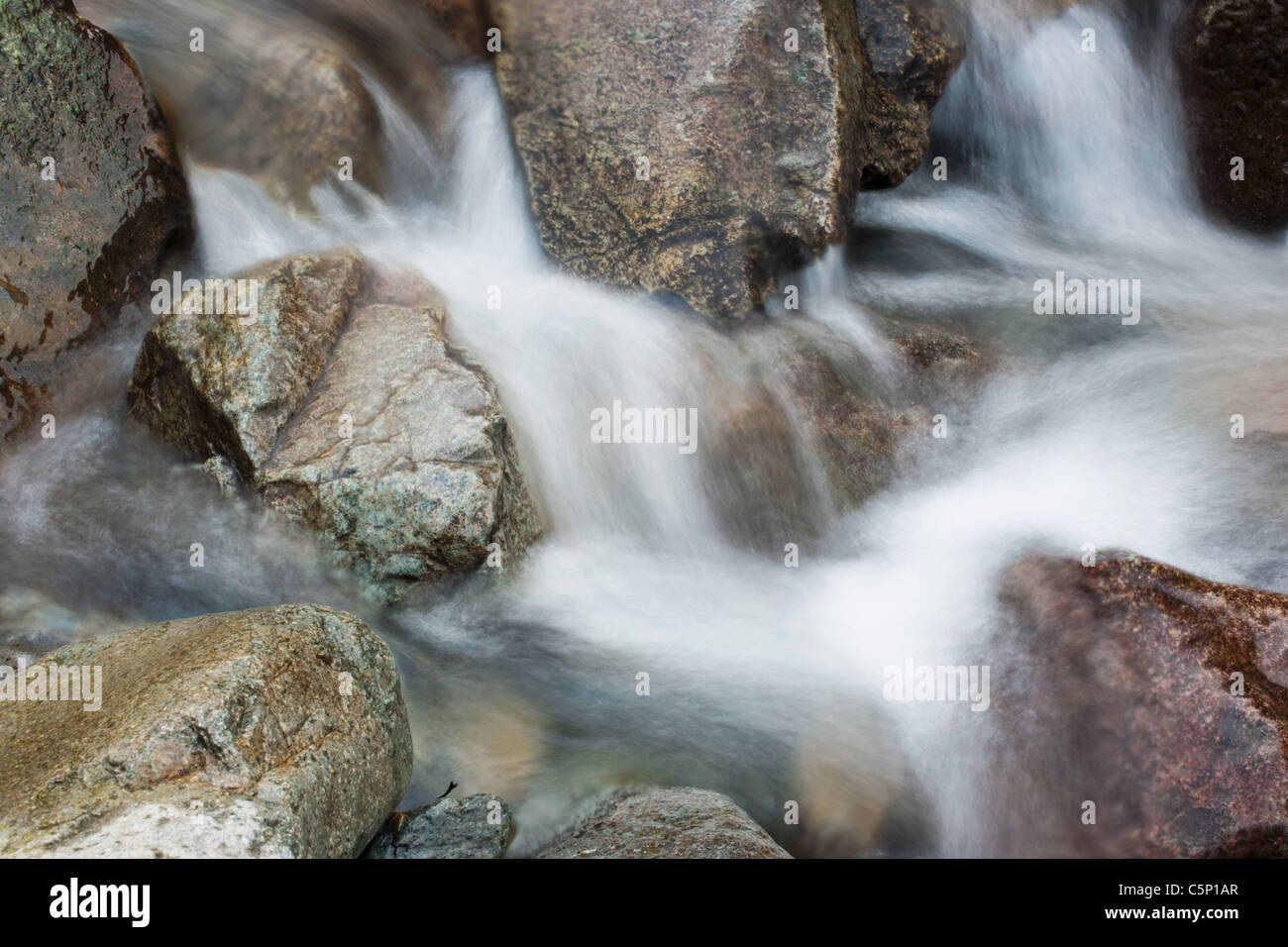 Water flowing over rocks - Stock Image