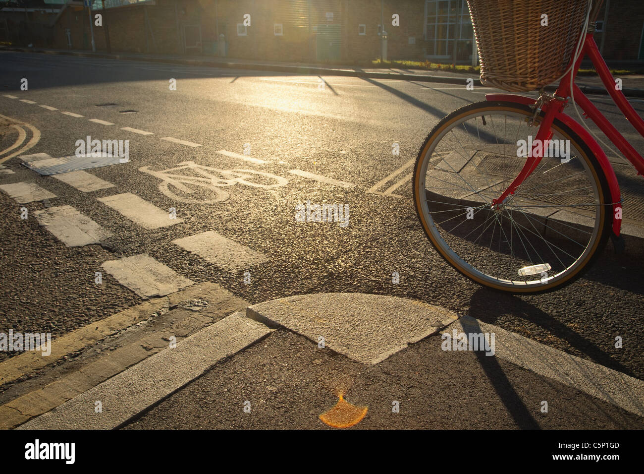 Road with cycle path and bicycle - Stock Image