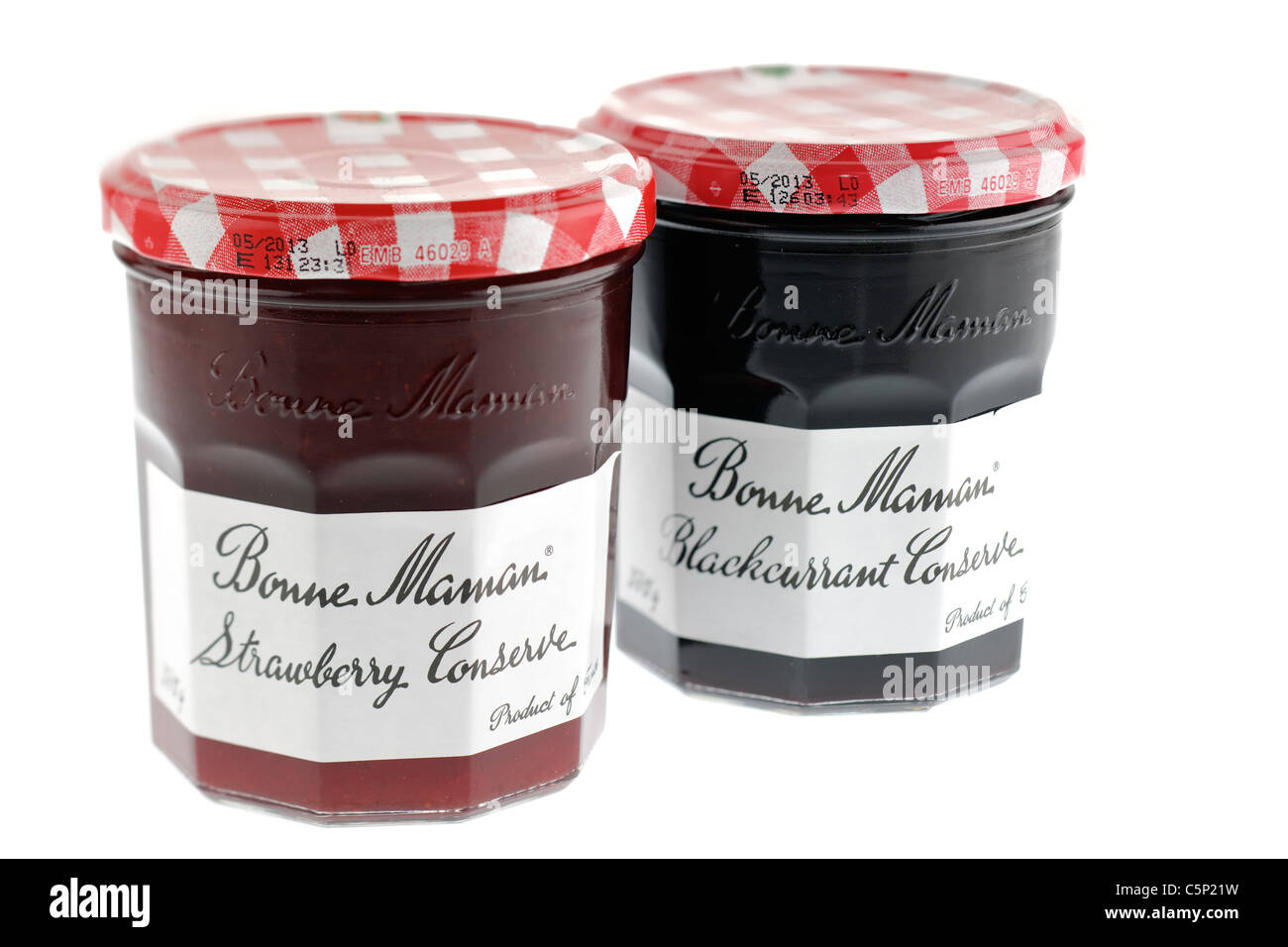 Two Jars of Bonne Maman conserve one of Strawberry and one of Blackcurrant. - Stock Image