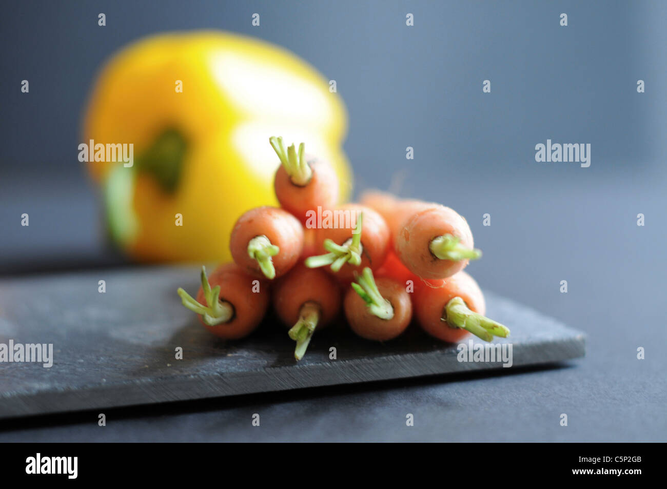 Carrots and one yellow sweet pepper bell Stock Photo