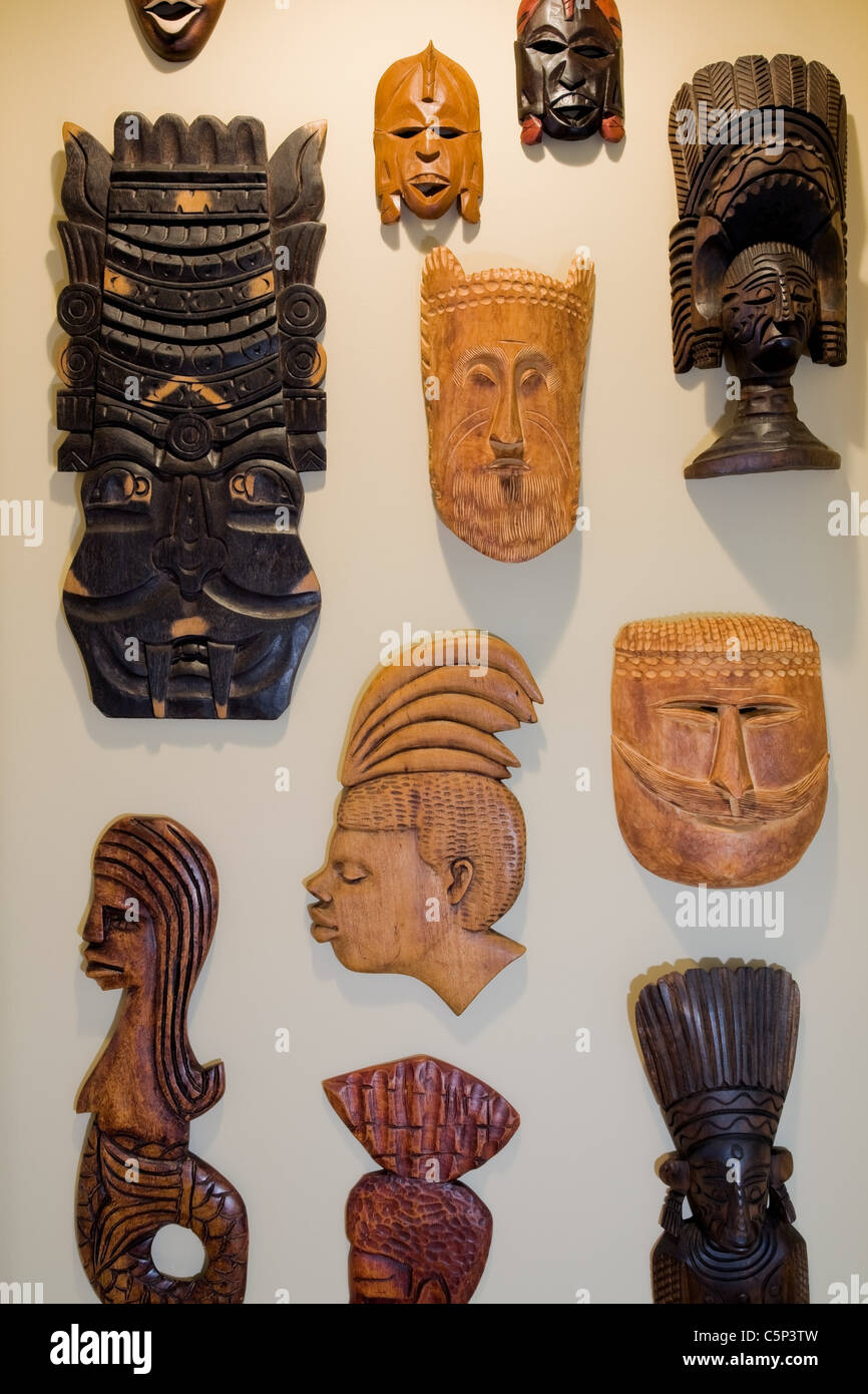 Wooden masks on wall - Stock Image