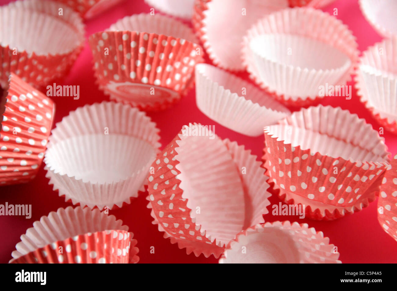 Pink Muffin cases with white dots - Stock Image