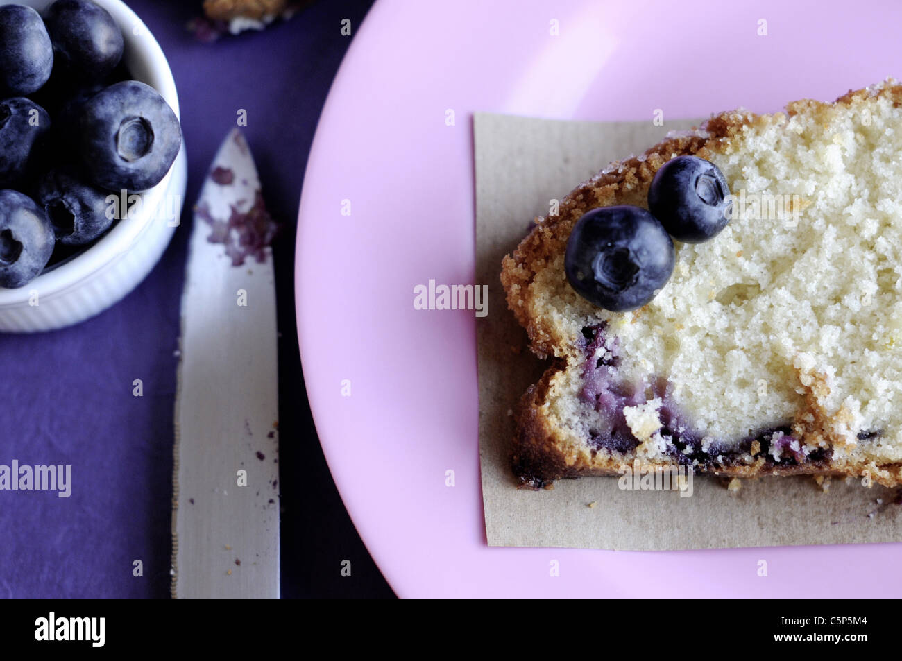 Lemon blueberry cake on a pink plate - Stock Image