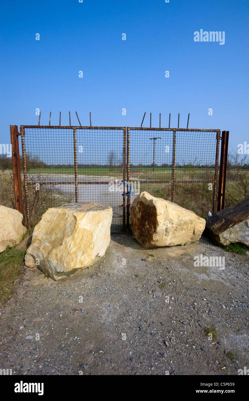 padlocked gates of industrial near Leeds Yorkshire UK - Stock Image
