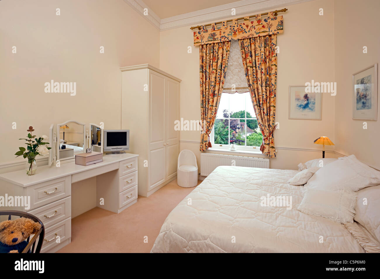 Interior of a traditional english bedroom - Stock Image