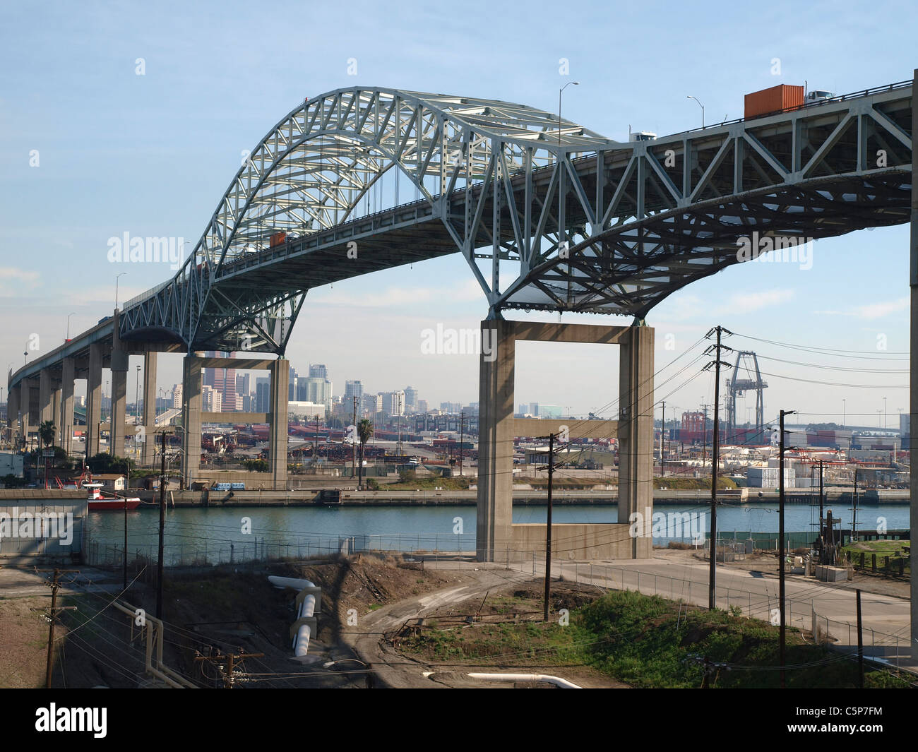 Metal span bridge in a industrial section of Long Beach California. - Stock Image