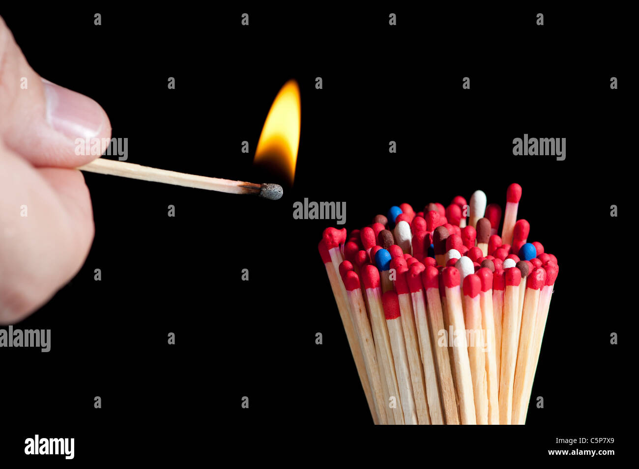ignition of group multicolored matches, isolated on black background - Stock Image