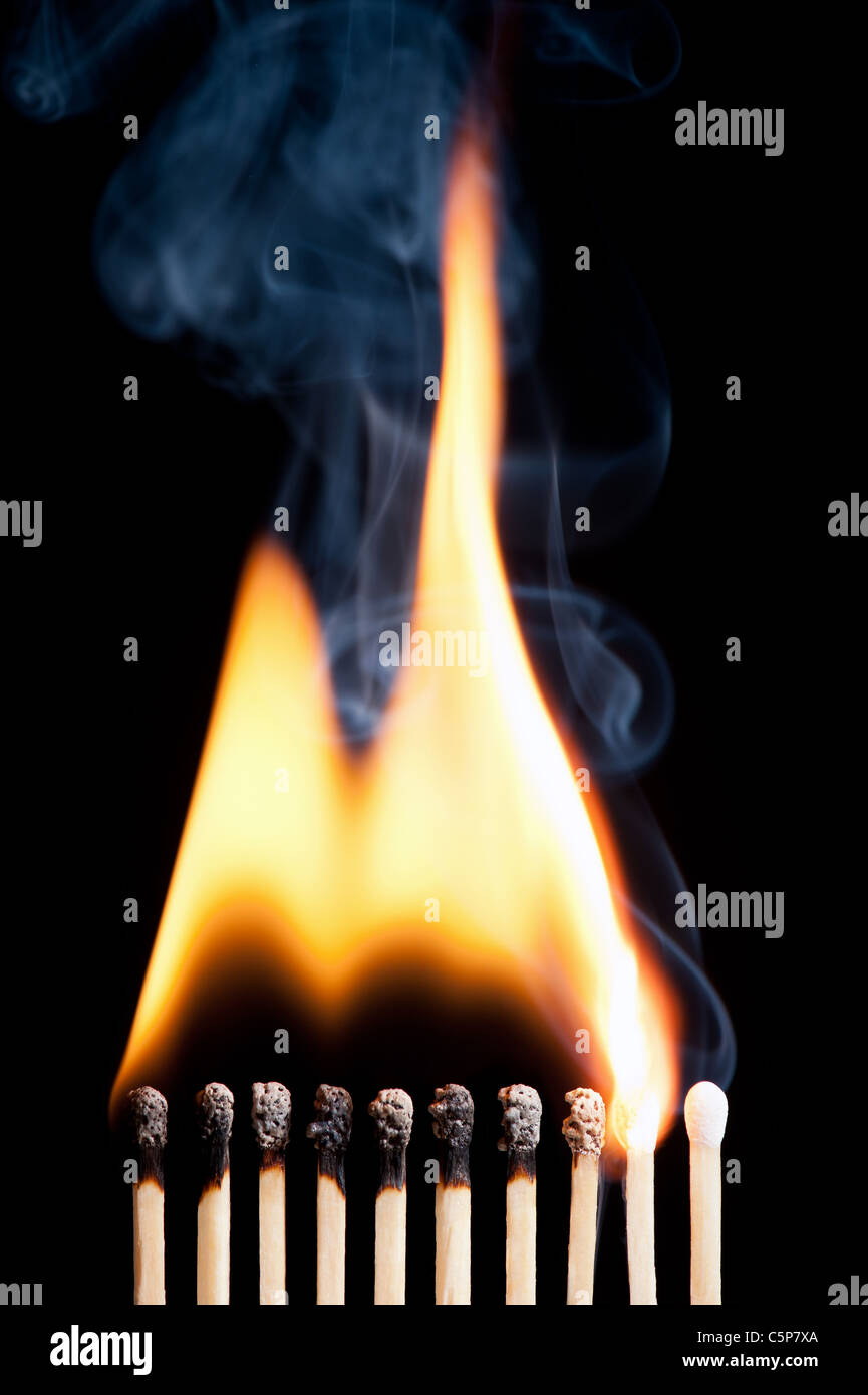 group of burning matched on black background (the last match is not in fire) - Stock Image