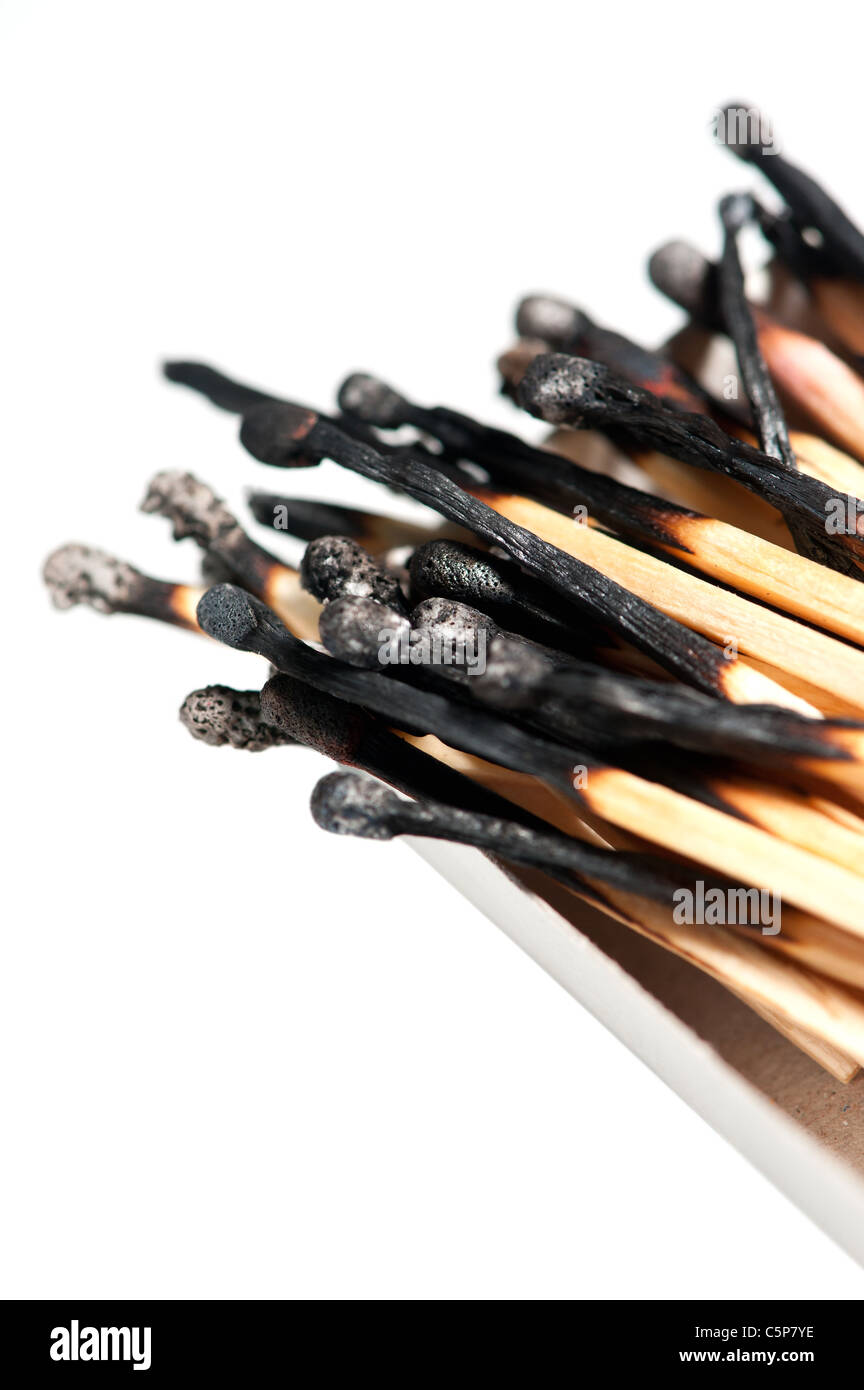 burned matches in a box, isolated on white background - Stock Image