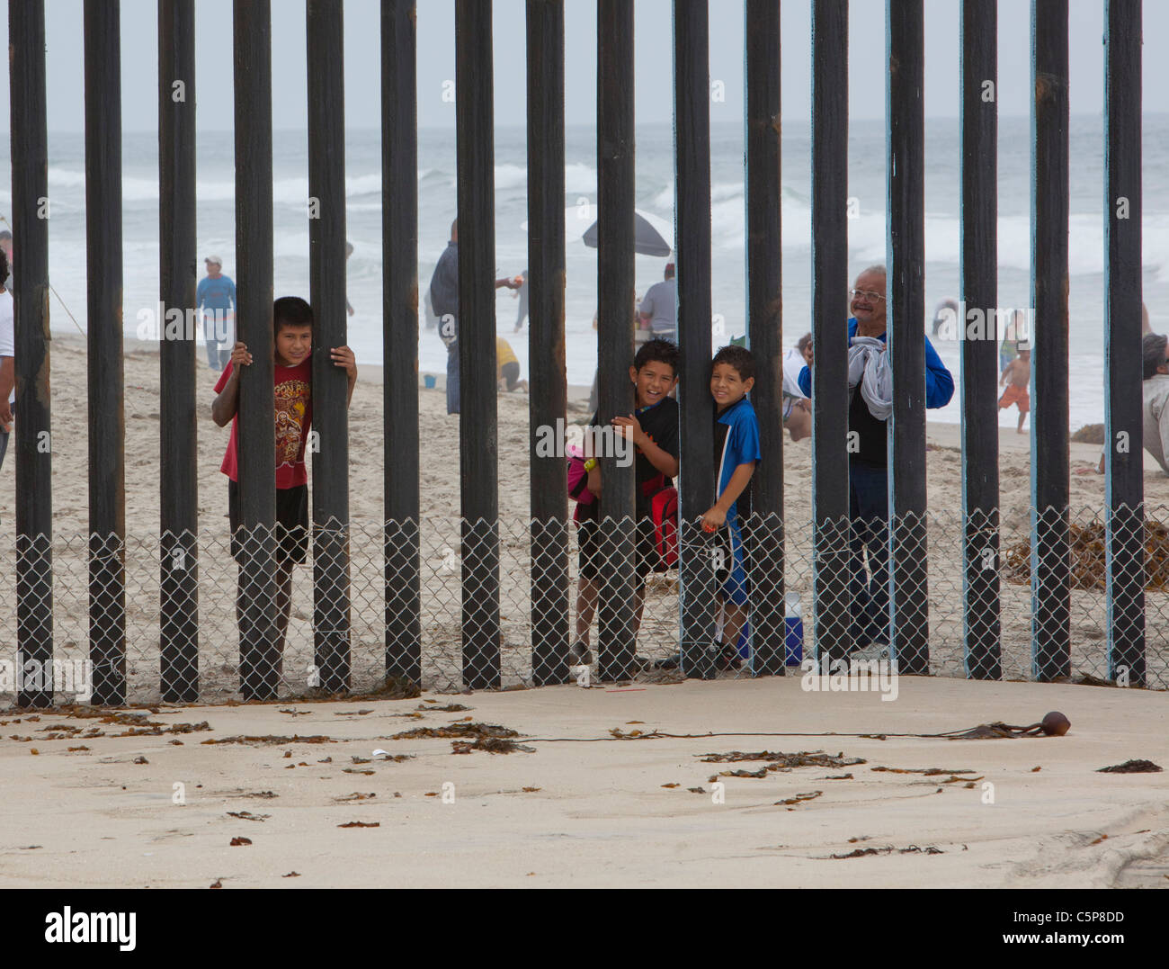 U.S.-Mexico Border Fence at Pacific Ocean - Stock Image