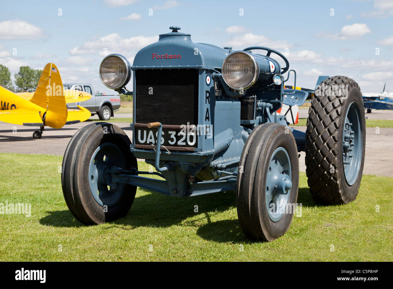 Vintage Fordson tractor painted as an RAF vehicle - Stock Image