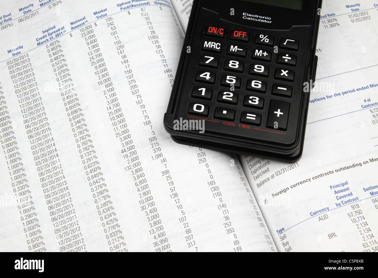 Looking over an investment annual report. - Stock Image