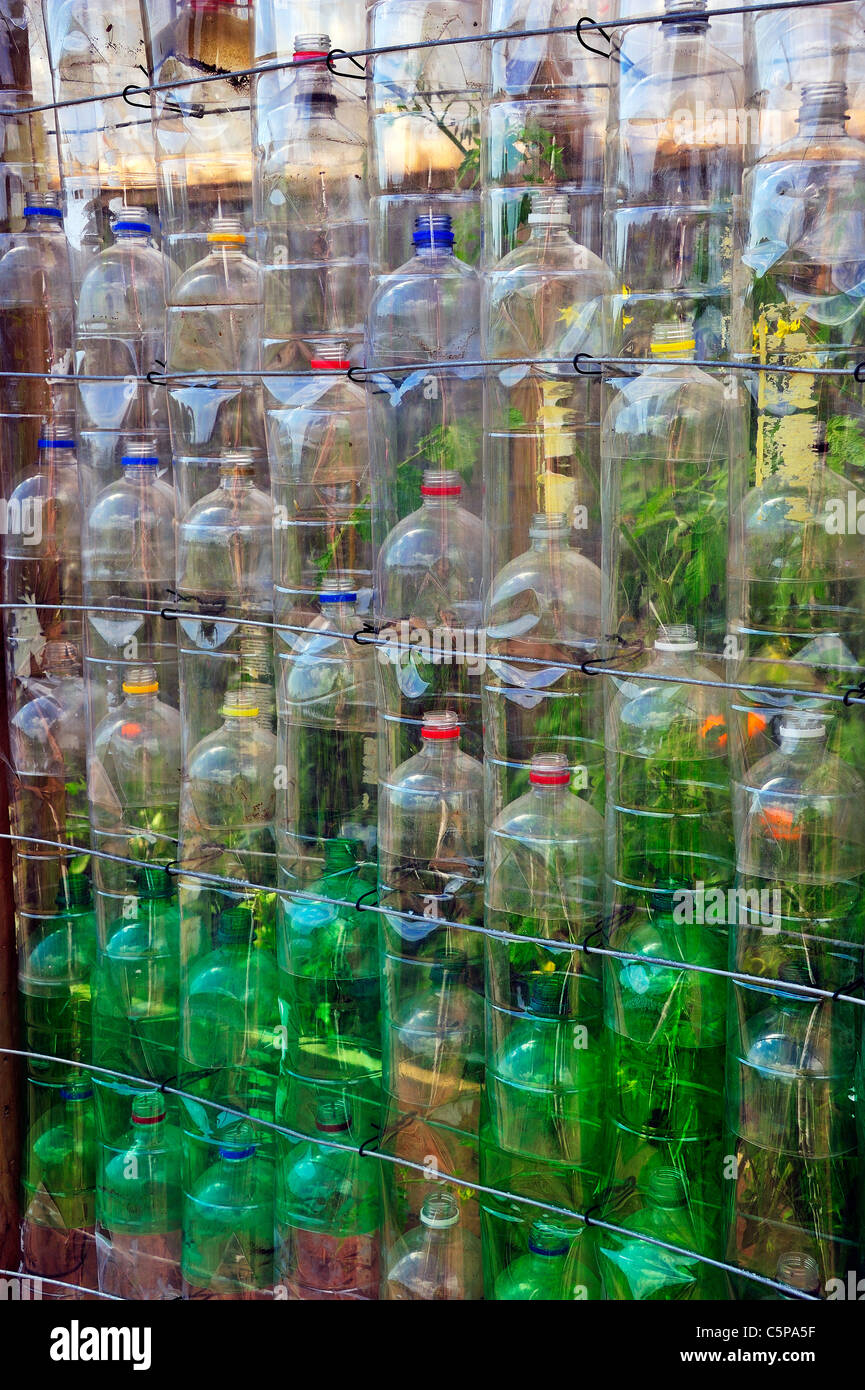 Detail of the wall of a greenhouse made out of old plastic bottles. See image C5P7YW for a view of the complete - Stock Image