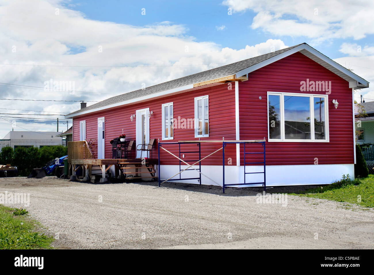 Newly Constructed Red Vinyl Siding Mobile Home At The