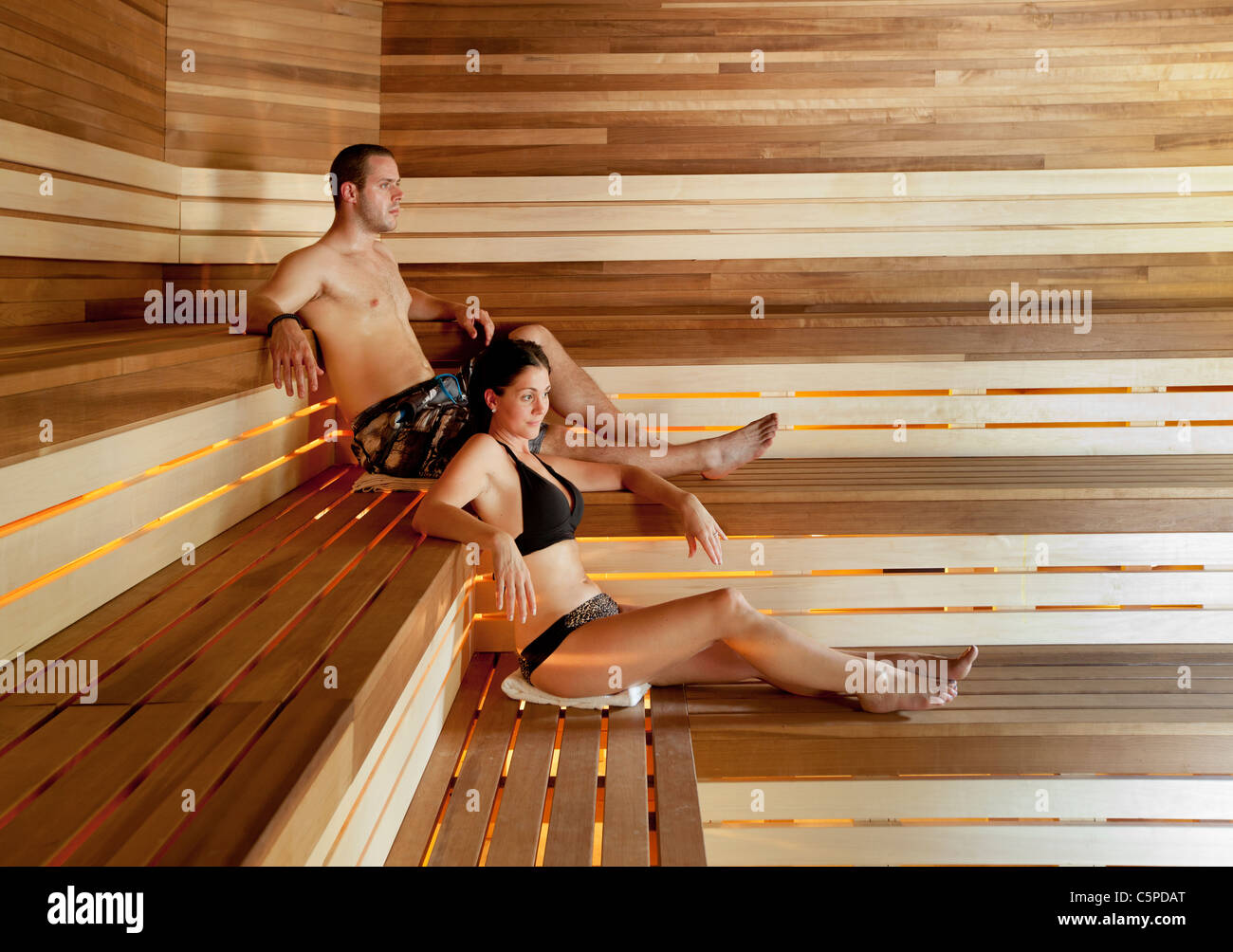 Young couple relaxes in a dry sauna in a spa in Quebec, Canada - Stock Image