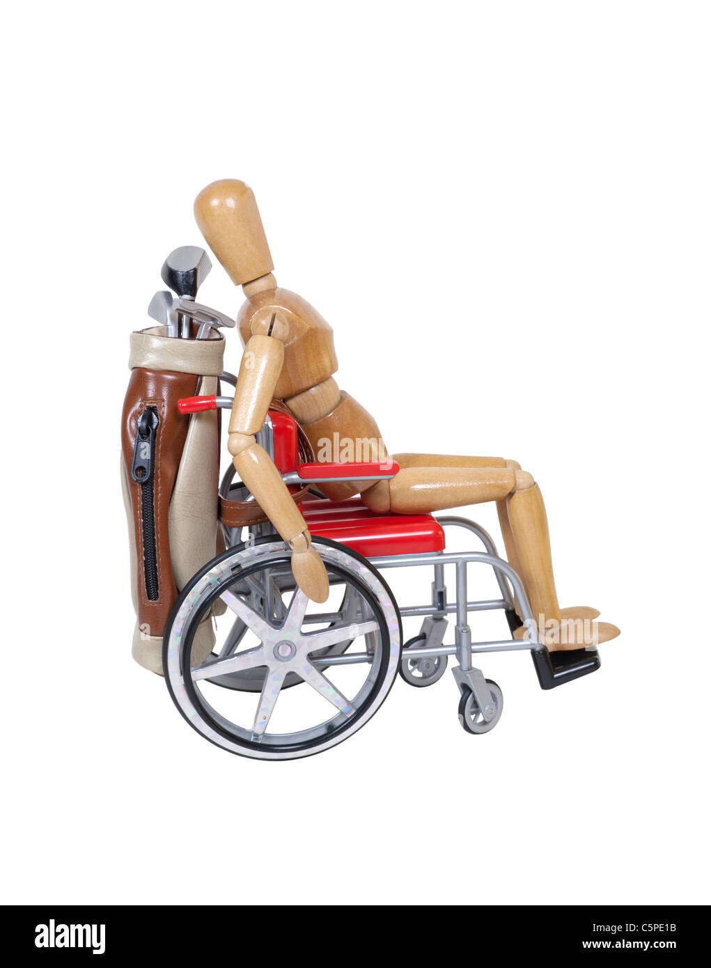 Riding in a wheelchair with a set of golf clubs in a golf bag - path included - Stock Image